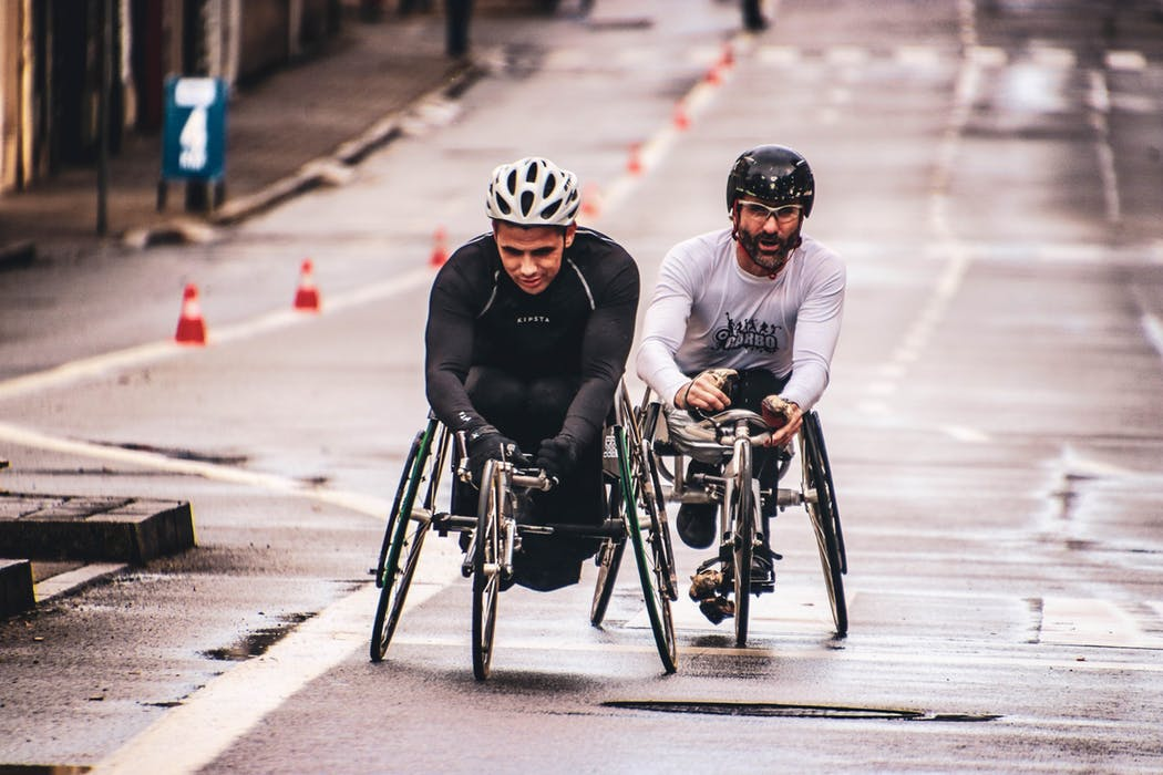 two men in their wheelchairs